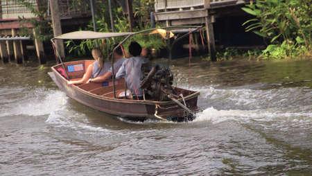 RATCHABURI,THAILAND-SEPTEMBER 19 : Unidentified People and Tourist on the boat tour Damneonsaduak Floating Market on September 19,2012 in Ratchaburi,Thailand. Editorial