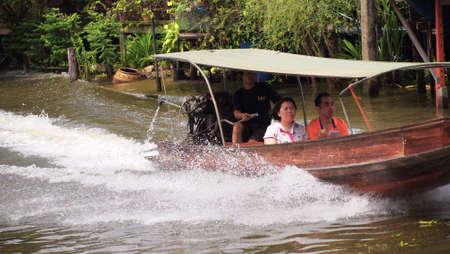 RATCHABURI,THAILAND-SEPTEMBER 21 : Unidentified People and Tourist on the boat tour Damneonsaduak Floating Market on September 21,2012 in Ratchaburi,Thailand.