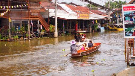 RATCHABURI,THAILAND-SEPTEMBER 22 : Unidentified People and Tourist on the boat tour Damneonsaduak Floating Market on September 22,2012 in Ratchaburi,Thailand.
