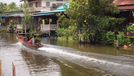 RATCHABURI,THAILAND-SEPTEMBER 24 : Unidentified People and Tourist on the boat tour Damneonsaduak Floating Market on September 24,2012 in Ratchaburi,Thailand.
