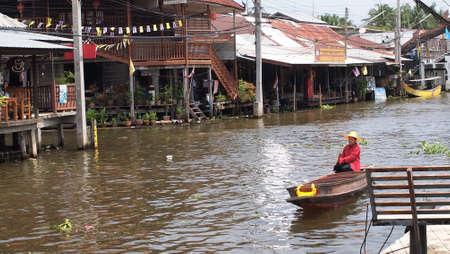 damneonsaduak: RATCHABURI,THAILAND-SEPTEMBER 4 : Unidentified People and Tourist on the boat tour Damneonsaduak Floating Market on September 4,2012 in Ratchaburi,Thailand.