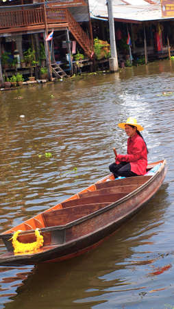 RATCHABURI,THAILAND-SEPTEMBER 29 : Unidentified People and Tourist on the boat tour Damneonsaduak Floating Market on September 29,2012 in Ratchaburi,Thailand.