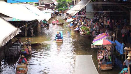 damneonsaduak: RATCHABURI,THAILAND-SEPTEMBER 6 : Unidentified People and Tourist on the boat tour Damneonsaduak Floating Market on September 6,2012 in Ratchaburi,Thailand.