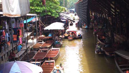damneonsaduak: RATCHABURI,THAILAND-SEPTEMBER 7 : Unidentified People and Tourist on the boat tour Damneonsaduak Floating Market on September 7,2012 in Ratchaburi,Thailand. Editorial