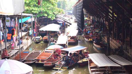 damneonsaduak: RATCHABURI,THAILAND-SEPTEMBER 10 : Unidentified People and Tourist on the boat tour Damneonsaduak Floating Market on September 10,2012 in Ratchaburi,Thailand.