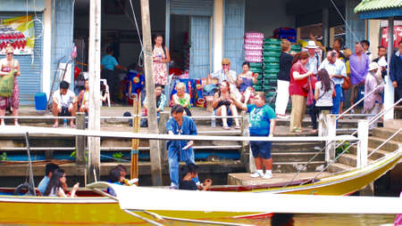 damneonsaduak: RATCHABURI,THAILAND-SEPTEMBER 12 : Unidentified People and Tourist on the boat tour Damneonsaduak Floating Market on September 12,2012 in Ratchaburi,Thailand. Editorial