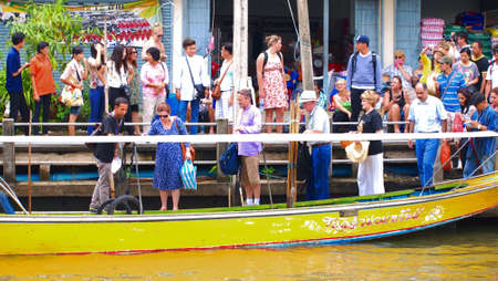damneonsaduak: RATCHABURI,THAILAND-SEPTEMBER 13 : Unidentified People and Tourist on the boat tour Damneonsaduak Floating Market on September 13,2012 in Ratchaburi,Thailand.