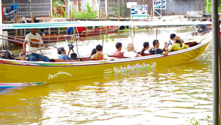 damneonsaduak: RATCHABURI,THAILAND-SEPTEMBER 16 : Unidentified People and Tourist on the boat tour Damneonsaduak Floating Market on September 16,2012 in Ratchaburi,Thailand.