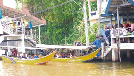 damneonsaduak: RATCHABURI,THAILAND-SEPTEMBER 17 : Unidentified People and Tourist on the boat tour Damneonsaduak Floating Market on September 17,2012 in Ratchaburi,Thailand. Editorial