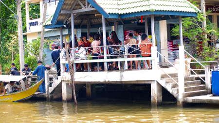 RATCHABURI,THAILAND-SEPTEMBER 18 : Unidentified People and Tourist on the boat tour Damneonsaduak Floating Market on September 18,2012 in Ratchaburi,Thailand.