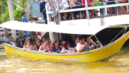 damneonsaduak: RATCHABURI,THAILAND-SEPTEMBER 19 : Unidentified People and Tourist on the boat tour Damneonsaduak Floating Market on September 19,2012 in Ratchaburi,Thailand. Editorial
