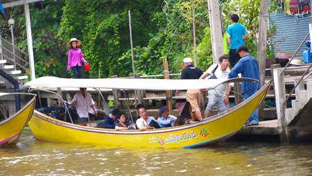RATCHABURI,THAILAND-SEPTEMBER 23 : Unidentified People and Tourist on the boat tour Damneonsaduak Floating Market on September 23,2012 in Ratchaburi,Thailand.