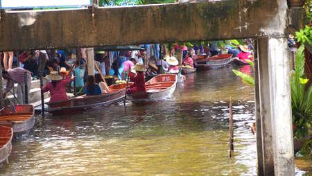 RATCHABURI,THAILAND-SEPTEMBER 26 : Unidentified People and Tourist on the boat tour Damneonsaduak Floating Market on September 26,2012 in Ratchaburi,Thailand.