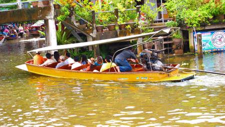 damneonsaduak: RATCHABURI,THAILAND-SEPTEMBER 28 : Unidentified People and Tourist on the boat tour Damneonsaduak Floating Market on September 28,2012 in Ratchaburi,Thailand. Editorial