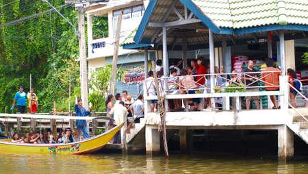 RATCHABURI,THAILAND-SEPTEMBER 1 : Unidentified People and Tourist on the boat tour Damneonsaduak Floating Market on September 1,2012 in Ratchaburi,Thailand.