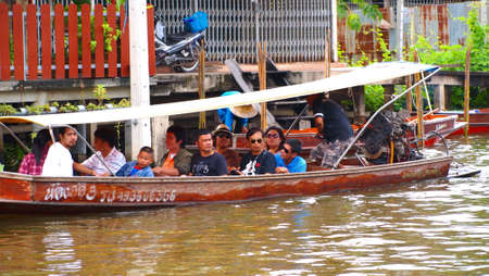 damneonsaduak: RATCHABURI,THAILAND-SEPTEMBER 2 : Unidentified People and Tourist on the boat tour Damneonsaduak Floating Market on September 2,2012 in Ratchaburi,Thailand.