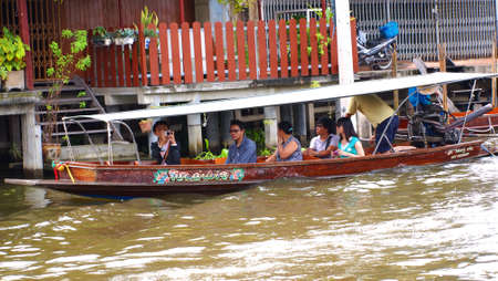 RATCHABURI,THAILAND-SEPTEMBER 3 : Unidentified People and Tourist on the boat tour Damneonsaduak Floating Market on September 3,2012 in Ratchaburi,Thailand.