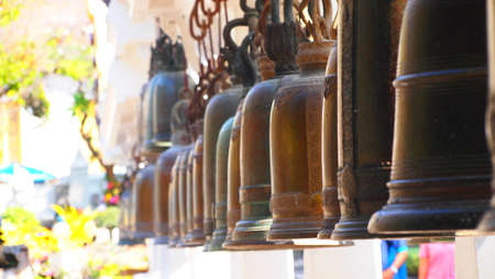 Thailand Old bells in a buddhist temple photo