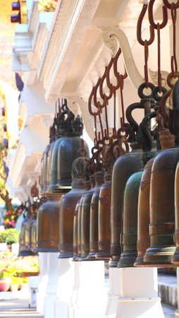 Ancient Bells in Buddhism temple, Thailand photo