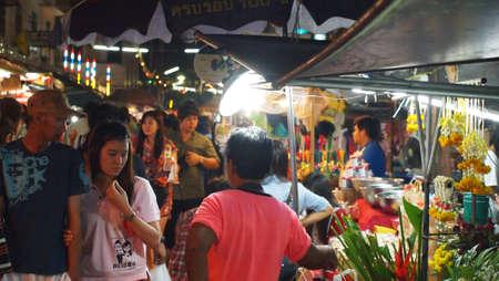 SAMUTSONGKHRAM,THAILAND-DECEMBER 1 : Unidentified People and Tourist at Amphawa Night Floating Market on DECEMBER 1,2012 in SAMUTSONGKHRAM,THAILAND.