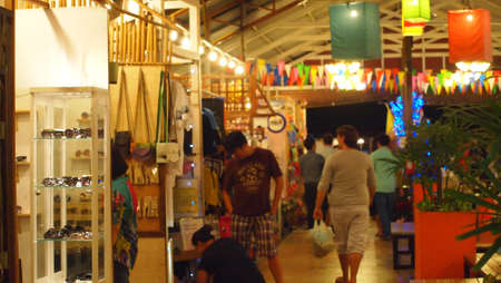 SAMUTSONGKHRAM,THAILAND-DECEMBER 1 : Unidentified People and Tourist at Amphawa Night Floating Market on DECEMBER 1,2012 in SAMUTSONGKHRAM,THAILAND. Stock Photo - 16817629