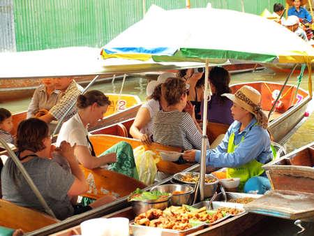 RATCHABURI,THAILAND-APRIL 13 : Unidentified People and Tourist at Damneonsaduak Floating Market on APRIL 13,2013 in Ratchaburi,Thailand. Editorial