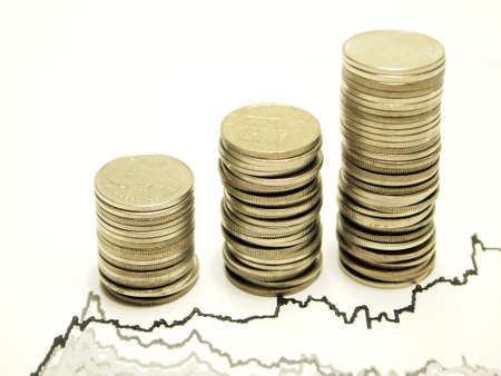 commercial activity: Coins and Graph isolated on white background  Stock Photo