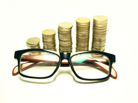 Money concept going up and Glasses isolated on white background          Stock Photo