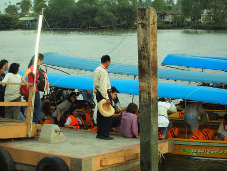 SAMUTSONGKHAM,THAILAND-February 25 : Unidentified People and Tourist on the boat tour Amphawa Floating Market on February 25,2014 in SAMUTSONGKHAM,Thailand.