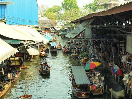 RATCHABURI,THAILAND-February 26 : Unidentified People and Tourist on the boat tour Damneonsaduak Floating Market on February 26,2014 in Ratchaburi,Thailand.