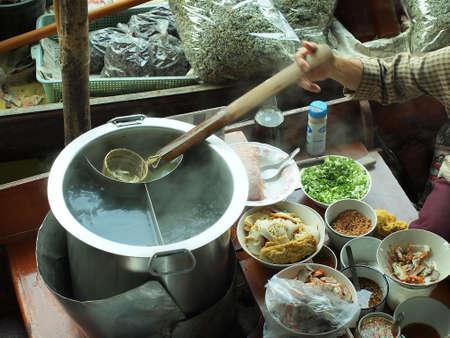 Food vendor at Damnoen Saduak Floating Market, Thailand