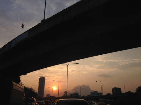 Traffic Jam in Bangkok Thailand View Sunset on cars under  bridge