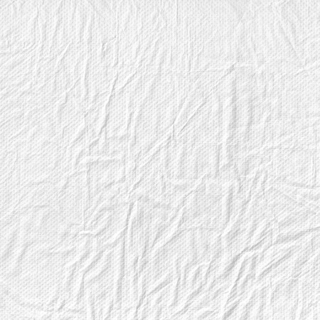 Perforated crumpled fluffy white paper photo texture. Wrapping paper with wrinkles for your design. photo