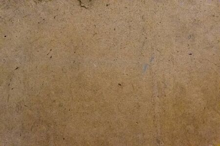 Close up grunge cardboard photo texture. Background for your design in loft style.