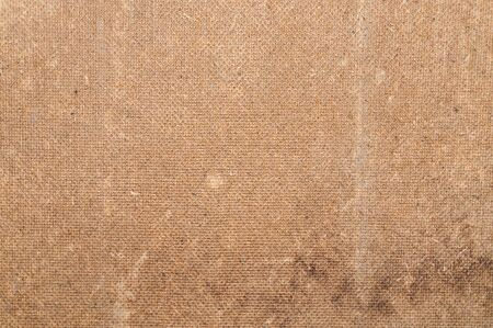 Close up stamped dirty cardboard photo texture. Background for your design in loft style.