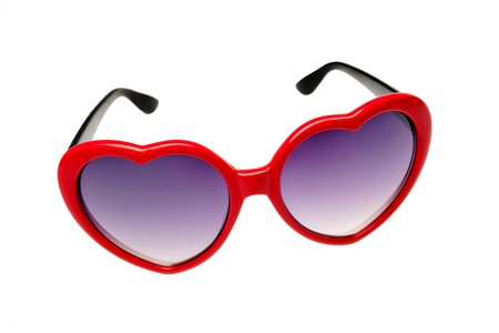 Red glasses in the shape of a heart on a white background photo