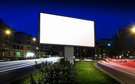 blank billboard: white display advertising with traffic at night