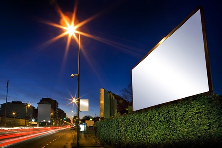 white display advertising with traffic at night photo