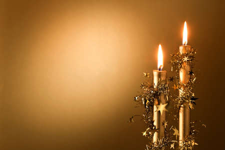 nicety: two golden candles with stars