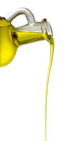 aceite de oliva: Botella con un hilo de aceite de oliva Foto de archivo