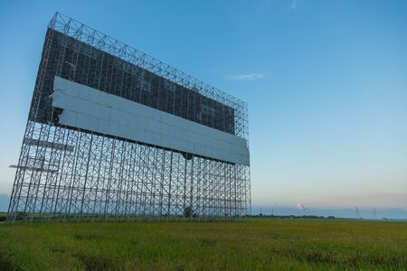 show bill: Big advertisement board structure in rice field.