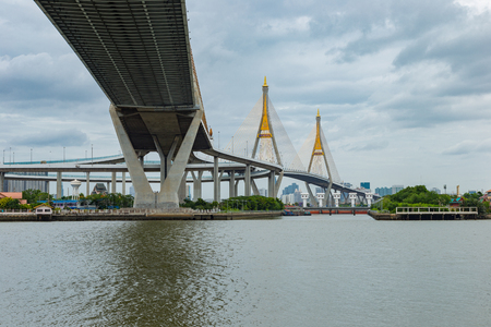 city park boat house: Bhumiphol highway bridge across Chaopraya river in Thailand Stock Photo