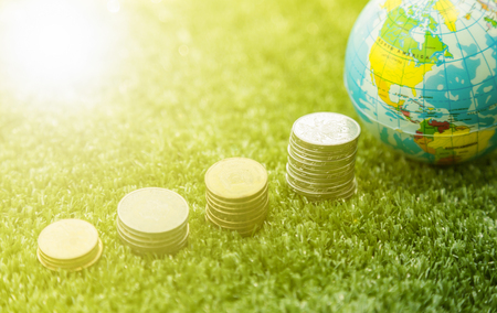 small world: Small world map and coins money stack Stock Photo