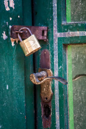 vintage padlock and handle at green door photo