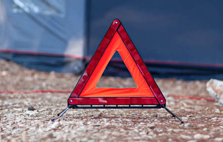 reflective: reflective red triangle car accessory alert sign Stock Photo