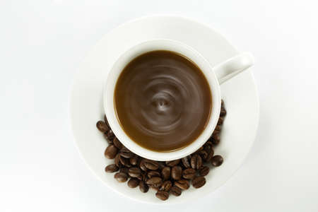 hot coffee and coffe beans photo