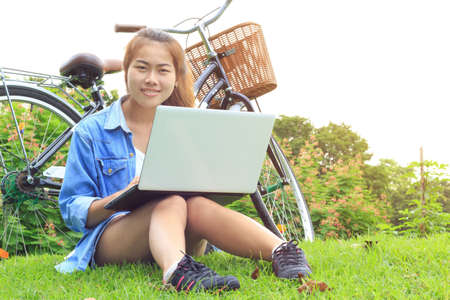 Portrait Asian woman use laptop computer in the park, Asia photo
