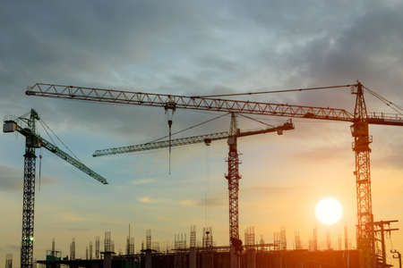construction crane on sunse photo