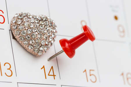 pitch peg on calendar and love symbol fourteen love day Stock Photo