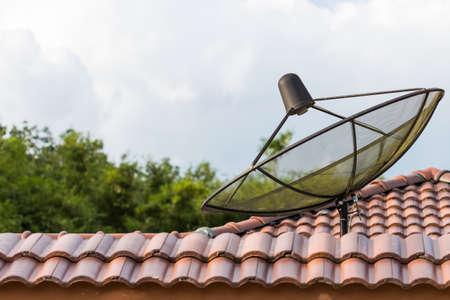 telecommunication satellite on roof photo